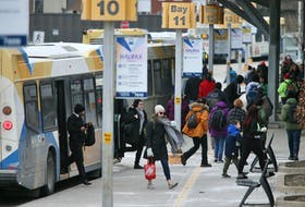 Halifax Transit passengers disembark from buses at the Bridge Terminal in Dartmouth on Monday, March 9, 2020.