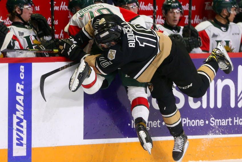 Charlottetown Islanders  Brett Buudgell, crunches Halifax Mooseheads Jason Horvath during QMJHL action in Halifax Sunday March 14, 2021.  TIM KROCHAK PHOTO
