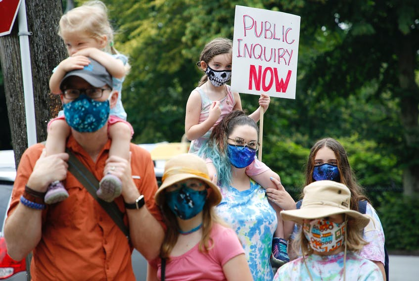 FOR MUNRO STORY: Several dozen people attended a noon-hour rally, in support of a call for a public inquiry for the April's mass shooting....in Victoria Park in Halifax Monday July 27, 2020.  TIM KROCHAK/ The Chronicle Herald