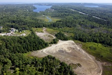 The tailings pond of the former Montague Gold Mine is seen near Dartmouth on Tuesday, July 28, 2020. The acting auditor general says that the province is disorganized when identifying and cleaning up contaminated sites. This is one of two former gold mines slated for cleanup.