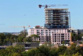 Construction cranes are seen over south-end Halifax Monday. The province was checking all crane sites in the municipality ahead of hurricane Teddy nearing the province.
