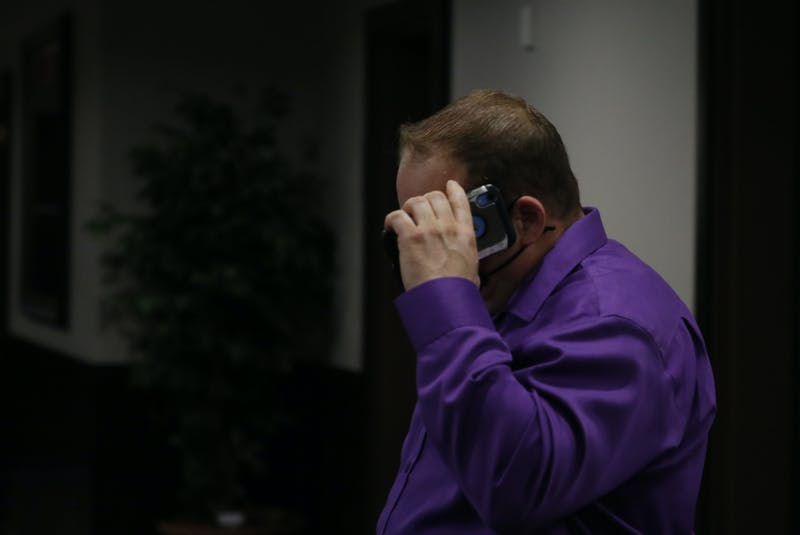 Halifax Regional Police Const. Steve Logan, shields his face with his phone, during a break in proceedings of the Nova Scotia Human Rights Commission at a Halifax hotel Thursday, Nov. 5, 2020. - Tim Krochak / File