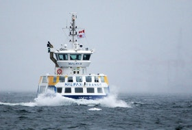A Halifax ferry plies the choppy waters shortly after service resumed following inclement weather in Halifax Harbour on Monday November 16, 2020.
