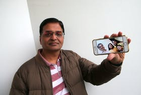 Gaurav Sadh, displays a family photo of himself, his wife Sakshi, daughter Krisha and son, Vivaan, taken last October, and seen in Halifax Friday, Nov. 20, 2020. His family has been left stranded in India since March due to the COVID-19 pandemic.