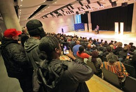 A woman records Halifax Regional Police Chief Dan Kinsella as he apologizes for his department's street check policy during a public event at the Halifax Central Library on Friday, Nov. 29, 2019.