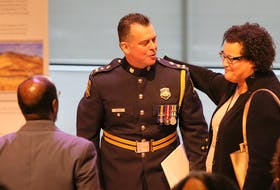 Halifax Regional Police Chief Dan Kinsella is congratulated by Natalie Borden, chairwoman of the Halifax police commission, after apologizing for his department's street check policy, during a public event at the Halifax Central Library on Friday, Nov. 29, 2019.