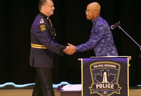 Halifax Regional Police Chief Dan Kinsella shakes hands with Quentrel Provo after the chief apologized for his department's street check policy during a public event at the Halifax Central Library on Friday, Nov. 29, 2019.
