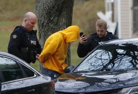 FOR NEWS STORY: RCMP officers take a man into custody on Ashburn at Elliott St in Halifax Wednesday December 9, 2020. It was near the scene wear an unmarked police vehicle collided with a vehicle into a pole....SEE STU STORY FOR MORE DETAILS.  TIM KROCHAK PHOTO