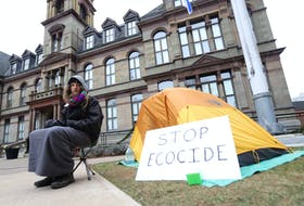 """FOR CAMPELL STORY: Since Tuesday, Jacob Fillmore has been seen camped out in front of City Hall, seen in Halifax Thursday December 17, 2020. He is reacting to an injunction recently served against forest defenders near Digby. """" I came to the decision to camp out on Grand Parade in protest against the Nova Scotia Government's inaction regarding key environmental issues and in support of those who defied the injunction to protect mainland moose habitat. I strongly believe that there is no denying we are in the middle of a climate and ecological crisis.""""  TIM KROCHAK PHOTO"""