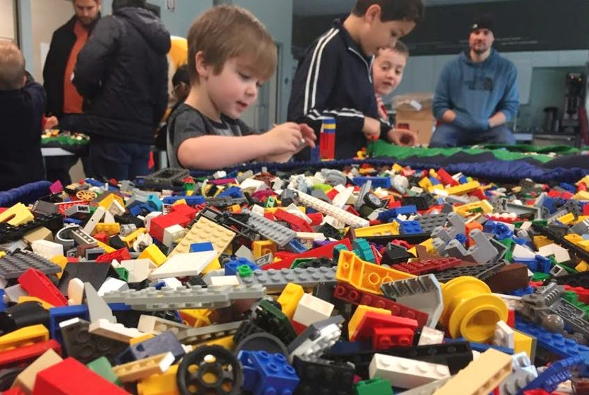 Children on Saturday morning build structures with Lego blocks as a part of NL Architectural Week.