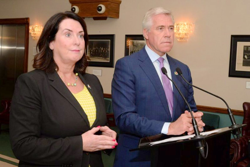 Natural Resources Minister Siobhan Coady and Premier Dwight Ball speak to the media outside the House of Assembly on Tuesday afternoon about recent public comments made by former Nalcor Energy CEO Ed Martin pertaining to the Muskrat Falls hydroelectric project.