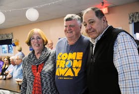 New York tourists Joe and Peggy Paparone pose with Gander Mayor Claude Elliott (centre) during the Gander Tony Awards Sunday night.
