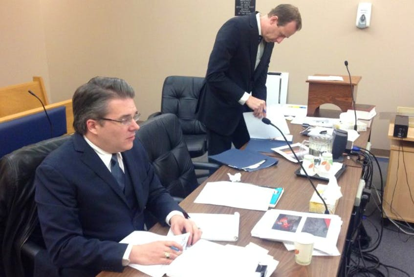 Defence lawyer Mark Gruchy (foreground) and Crown prosecutor Jude Hall prepare for the start of the preliminary inquiry into the triple attempted murder case of David Loveys in provincial court in St. John's Wednesday.