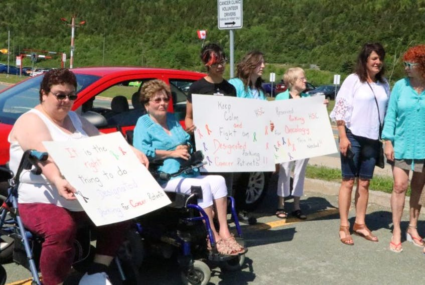 Cancer patients and supporters hold a demonstration Tuesday morning near the Dr. H. Bliss Murphy Cancer Centre. The group wants Eastern Health to designate 25 parking spaces close to the centre for cancer patients.