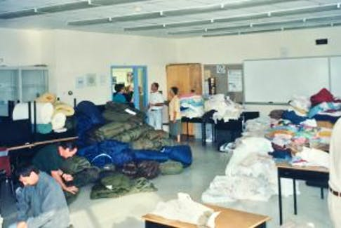 ['American Kevin Tuerff, one of almost 7,000 airline passengers stranded in Gander during the events of Sept. 11, 2001, was amazed at the kindness of local residents, who donated whatever they could to help. Pictured is a room in the Gander campus of College of the North Atlantic, filled with donated sleeping bags, blankets, pillows and other items for the passengers.']
