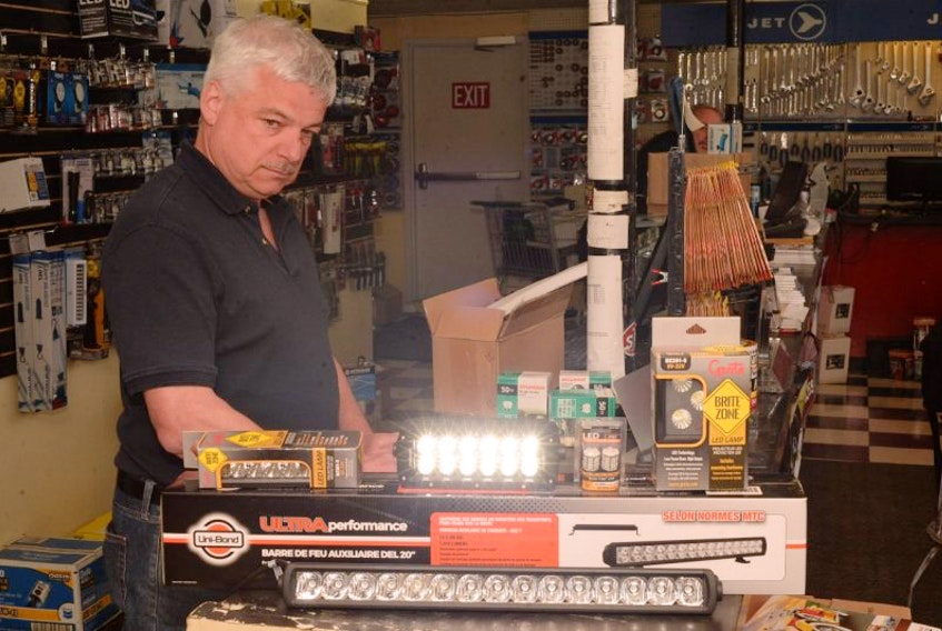 Phil Murphy, general manager of Colonial Garage & Distributors Ltd. in the west end, alongside a variety of LED lights at the outlet on Friday morning.