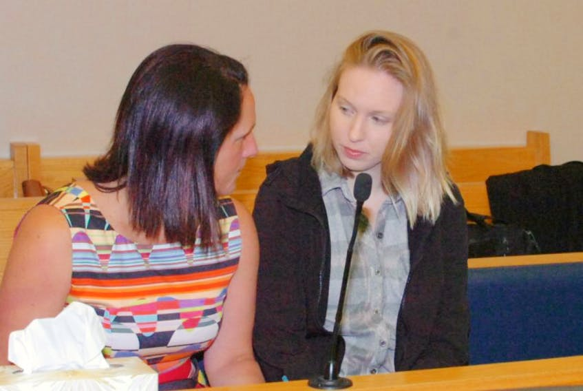 Accused murderer Anne Norris (right) speaks to her lawyer Rosellen Sullivan prior to the start of proceedings at provincial court in St. John's Tuesday.