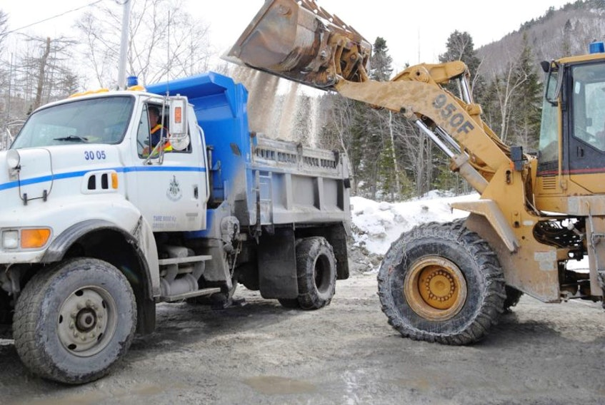 Road salt is loaded onto a truck at the City of Corner Brook's works depot on Charles Street. Salt spread on roads gives motorists traction, but it also eats away at their vehicles.