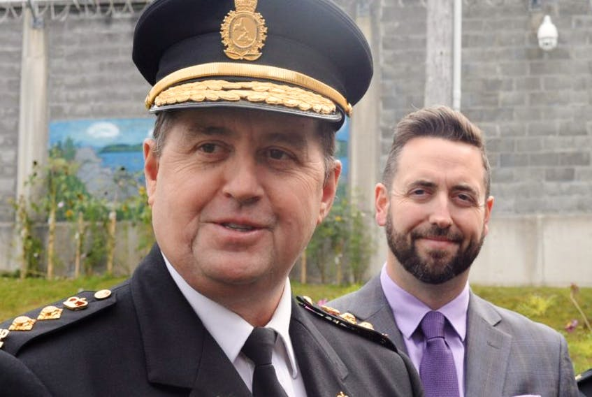 Owen Brophy (left), superintendent of prisons for Newfoundland and Labrador, and Minister of Justice and Public Safety Andrew Parsons speak to reporters at Her Majesty's Penitentiary on Wednesday.