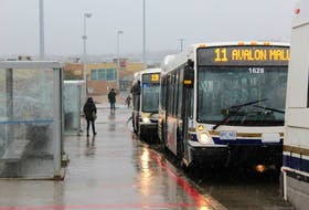 Buses filled up quickly at The Avalon Mall on early Friday afternoon, as people hurried to escape a messy mix of rain and blowing snow.