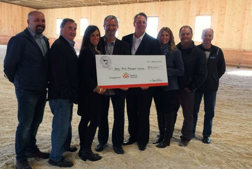 Representatives of the Newfoundland Labrador Building Trades Council present a cheque to Rainbow Riders recently.
