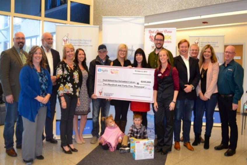 From left, Aiden Hibbs and Gina Pinsent (Steele Communications), Jim Haynes (Hydro) Annette Higdon (Hydro), Janine Browne (PAL Airlines),Toms Family (Jake, Nikita, Peyton & Liam), Christine Morgan (RMHC NL), Stephen Patten (St. John's Red Shoe Crew), Lana Roestenberg (RMHC NL), Steve Short (PAL Airlines), Gerry Beresford (past-chair, RMHC NL), Christine Adams and Darrell Hynes (Belfor)