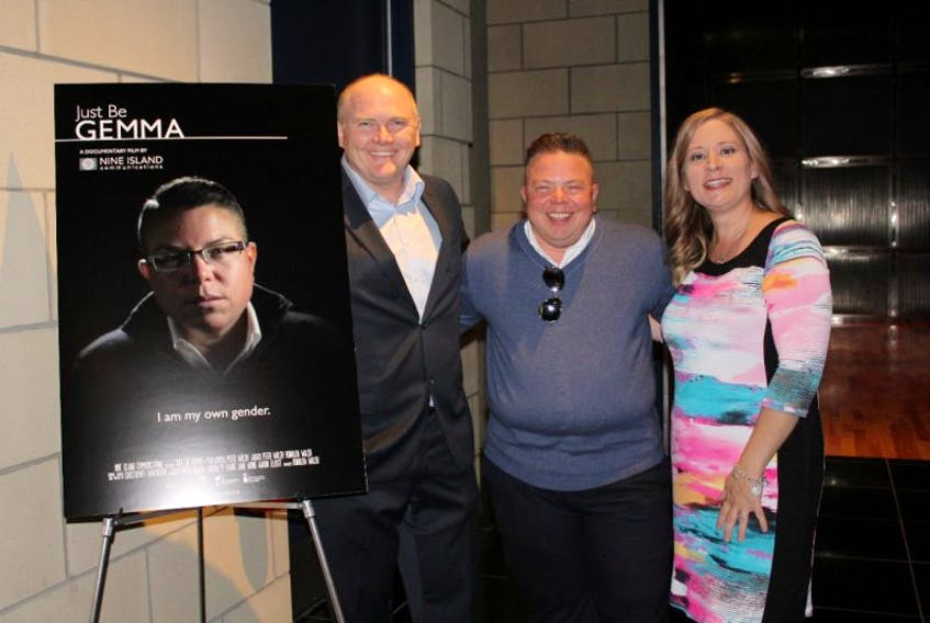 """Gemma Hickey (centre) smiles following the private premiere at The Room's in St. John's of """"Just Be Gemma,"""" a documentary produced by Peter and Ronalda Walsh of Nine Island Productions that chronicles Hickey's transition from female to non-binary."""