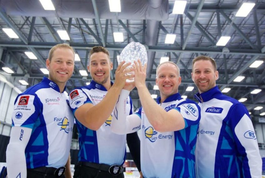 Brad Gushue (right) and teammates (from left) Geoff Walker, Brett Gallant and Mark Nichols hoist the championship trophy after winning the Tour Challenge in Regina on Sunday.
