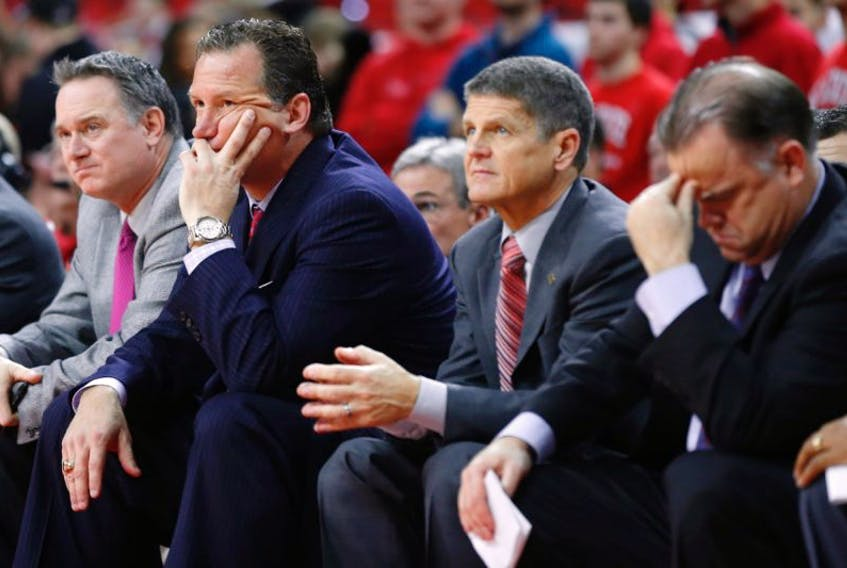 Jeff Dunlap, left, the former North Carolina State Wolfpack director of basketball operations, will become the first head coach in St. John's franchise history in the National Basketball League of Canada, The Telegram has learned. Dunlap, shown in this NC State file photo, is seated next to then-Wolfpack head coach Mark Gottfried, associate coach Bobby Lutz and assistant coach Rob Moxley.