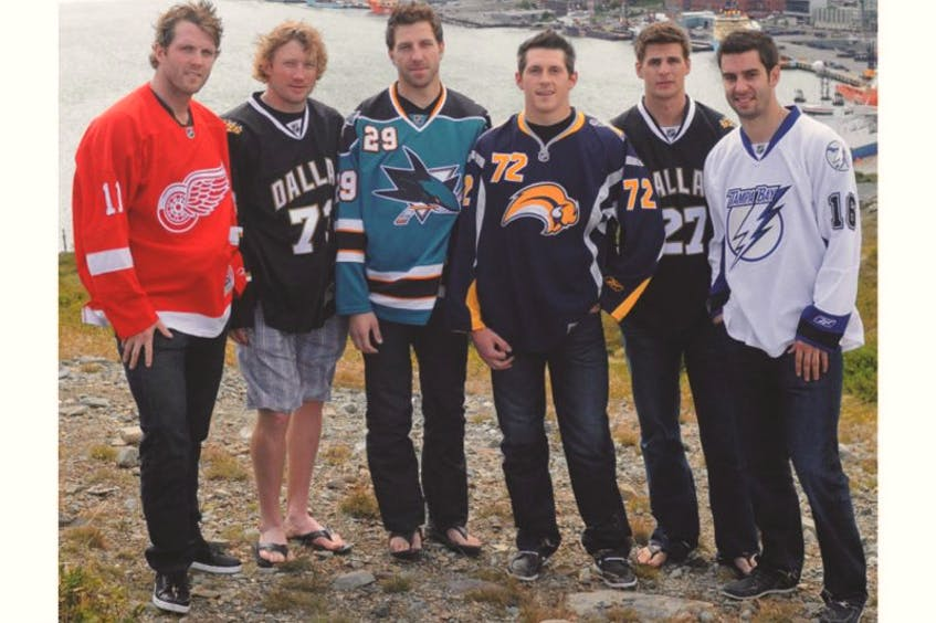 In this August 18, 2011 file photo, Newfoundlanders (from left) Danny Cleary, Michael Ryder, Ryane Clowe, Luke Adam, Adam Pardy and Teddy Purcell pose on Signal Hill in St. John's. The six, along with fellow Newfoundlander Colin Greening, had played in the National Hockey League the previous season. — Joe Gibbons/Telegram file photo