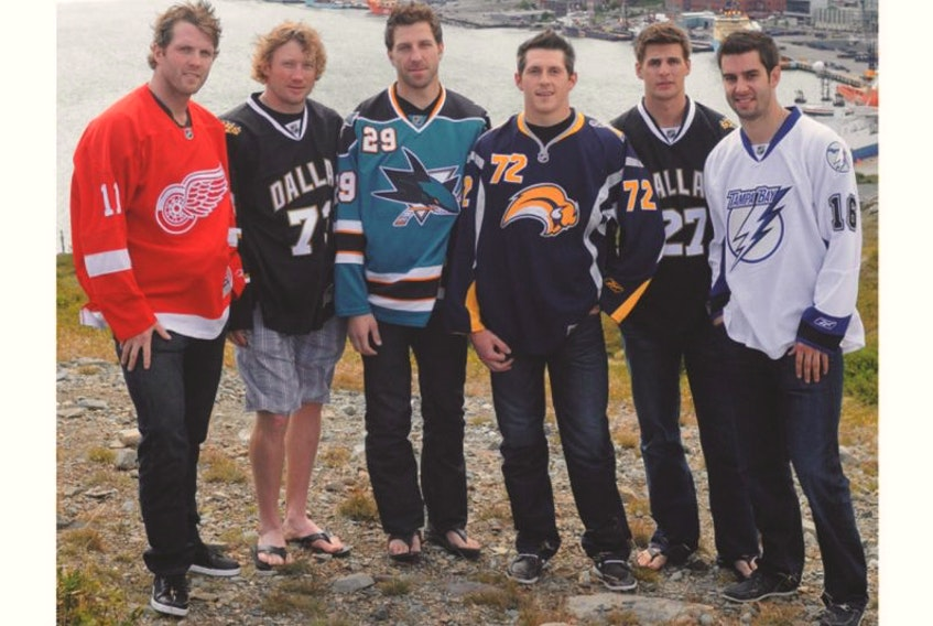 In this August 18, 2011 file photo, Newfoundlanders (from left) Danny Cleary, Michael Ryder, Ryane Clowe, Luke Adam, Adam Pardy and Teddy Purcell pose on Signal Hill in St. John's. The six, along with fellow Newfoundlander Colin Greening, had played in the National Hockey League the previous season, and all would see at least some time in the NHL in each of the next four seasons. However, as of this week, there is nobody from this province playing in the NHL.
