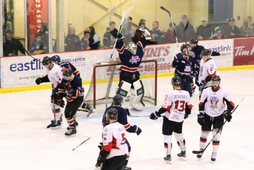 In this April 2, 2017 file photo, CeeBees goalie A.J. Whiffen raises his arms in celebration amid dejected members of the Central West Senior Hockey League's Clarenville Caribous at the conclusion of Game 5 of the Herder Trophy provincial senior hockey championship Sunday in Clarenville. Just five months after winning a Herder for the Avalon East Senior Hockey League, the AESHL's other four teams have told the CeeBees they are no longer wanted in the circuit. Meanwhile, the CWSHL is looking for a new team, but the CeeBees' president says a hook-up with the CWSHL is far from his team's preferred option.
