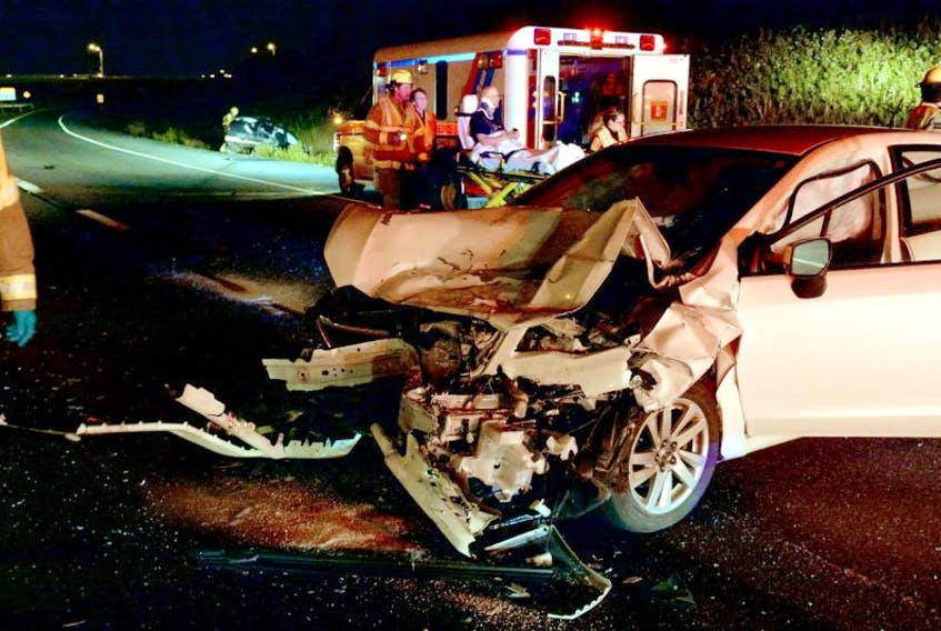 The driver of a car is placed aboard an ambulance following a moose collision on the Outer Ring road Wednesday night.