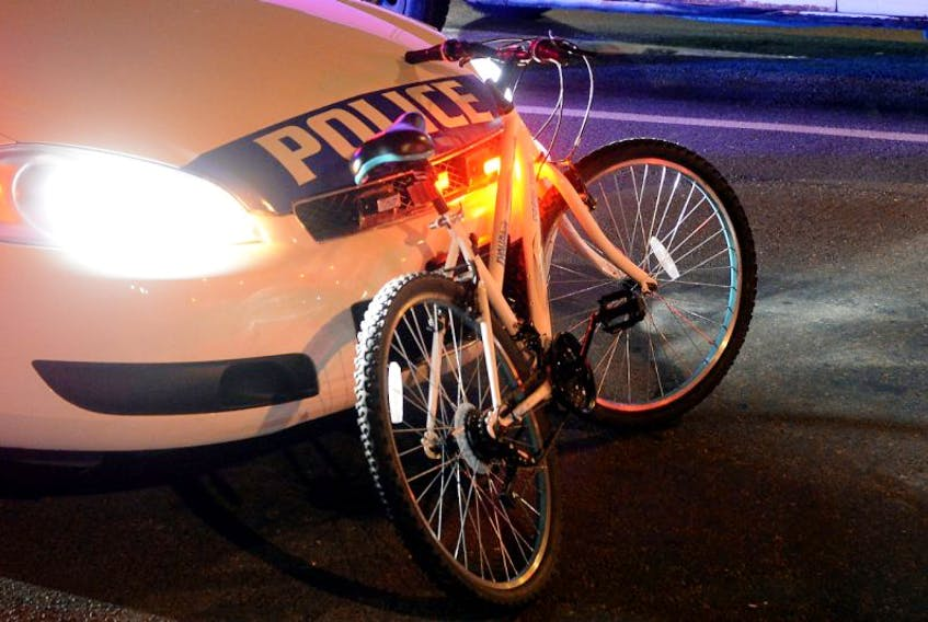 Officers with the Royal Newfoundland Constabulary investigate a bicycle-vehicle collision Thursday night.