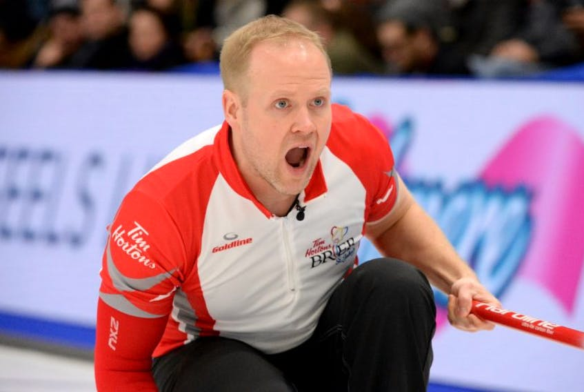 Newfoundland and Labrador third Mark Nichols calls a shot during the Sunday night draw of the Brier at Mile One Centre.