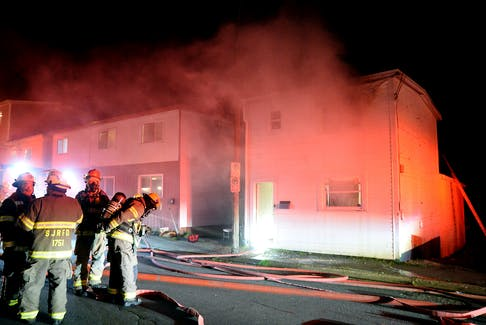 Firefighters rescued two men from the roof of buring home early Monday morning in St. John's. Keith Gosse/The Telegram