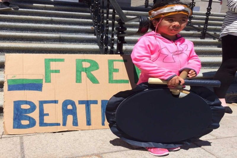 """Nine-year-old Brooklyn Wolfrey of Rigolet, Labrador, attends the """"Free Beatrice""""rally at the Colonial Building over the lunch hour Thursday. She is in St. John's from Rigolet with her mom Desiree Wolfrey. - Joe Gibbons"""