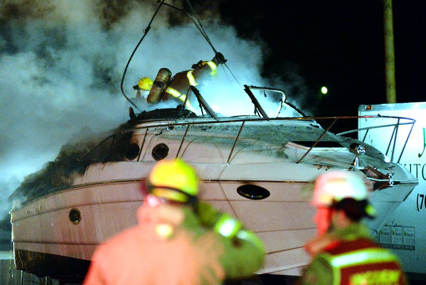 A boat was extensively damaged in an early morning St. John's Fire Friday. Keith Gosse/The Telegram