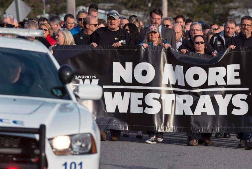 Friends and family march at a service to honour the 26 coal miners who perished in the Westray mine disaster at the Westray Miners Memorial Park in New Glasgow, N.S., May 9, 2017.