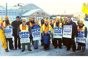 Striking workers stand outside the Hartland, N.B. office of Covered Bridge Potato Chips. — UFCW photo