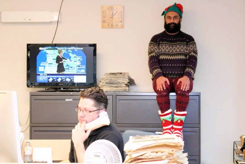 On Tibb's Eve, the Dark Elf on the Shelf (aka Project Kindness founder Hasan Hai) watches over The Telegram's assignment editor Mark Vaughan-Jackson (no word yet on what the elf plans to report back to Santa).