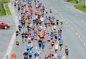 Participants stream down Topsail Road during the 2019 Tely 10 Road Race. The ongoing global COVID-19 pandemic has called into question whether or not this year's race will go ahead. Organizers would prefer to postpone the event to this fall, rather than cancel.