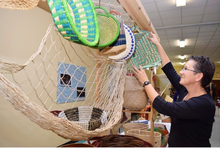 """<p class=""""copyright"""">Vee Reich adjusts a display of baskets during a craft fair held on Saturday at the Pictou United Church.&nbsp;</p>"""