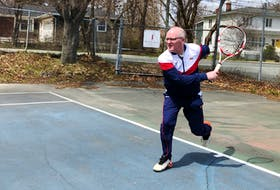 Mike Meaney of Tennis NL follows through on a serve to an imaginary opponent at the Riverdale Tennis Club in St. John's Monday.  Peter Jackson/Local Journalism Initiative reporter
