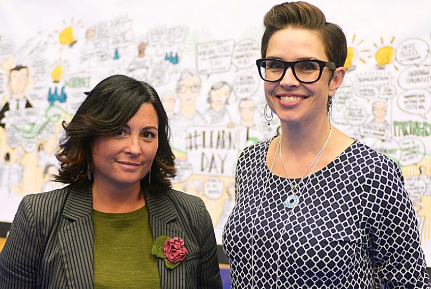 Learning Partners Advisory Council members, Michelle MacCallum, left and Bonnie Stewart, chat stand in front of a giant mural that illustrates the many topics discussed during the first ever Learn Day on P.E.I. The two were facilitators for the event, which was held in the Holland College Centre for Community Engagement, while the mural was created by Rachel Derrah and Isabel Chender of Brave Space.