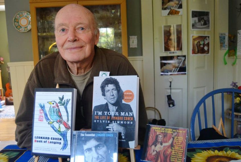 """Music enthusiast Noel Lyon shows some of his Leonard Cohen collection. The Summerside resident is teaching """"The Legacy of Leonard Cohen"""", a new course at Seniors College in Summerside this fall. Walk-in registration starts today."""