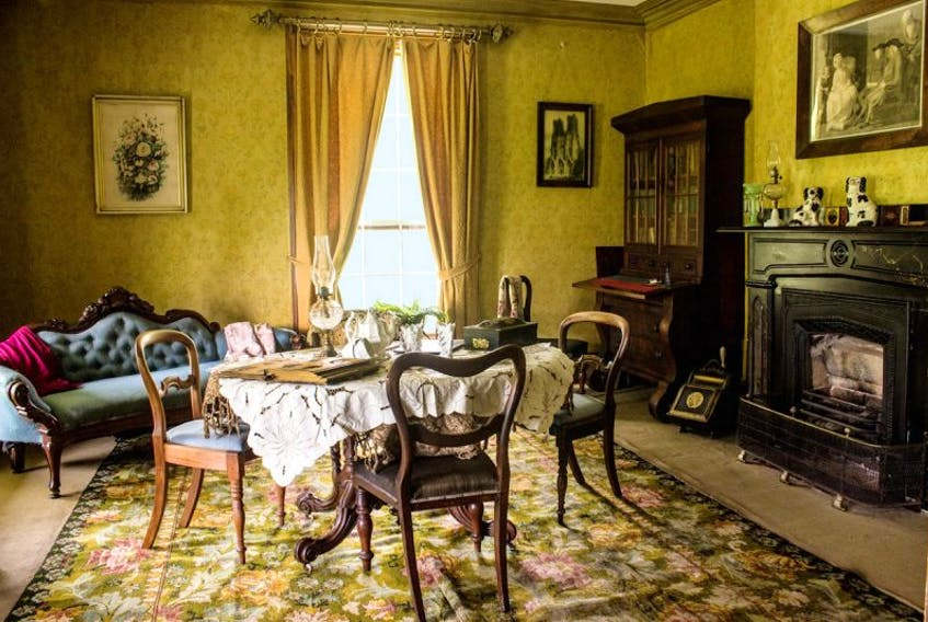 Historic furniture is shown in the principal parlour of Yeo House in Port Hill.