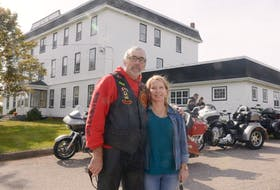 Dianne Young, chair of Lennon Recovery House Association, and Thanks for Giving motorcycle run organizer Donnie Aitken stand outside the recovery centre in South Rustico following the run on Saturday. About 150 motorcyclists helped raise more than $1,500 through the run.