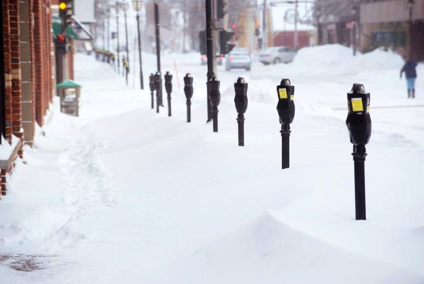 Meters are all lined up in the snow with no one to feed them as snow clearing operations for parking spaces took a back seat to snow removal on main streets this morning.