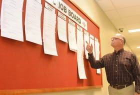 Garth Turtle, chairman of the board for the East Prince Youth Development Centre, looks over the organization's job board. The centre as an independent agency may soon cease to exist as the province redirects funding to a new organization that will provide similar services.